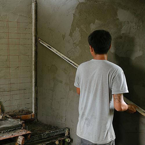 Håndværker Murer-glatter-væg-logo