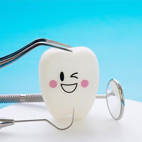 Tandlæge-glad-tand-logo